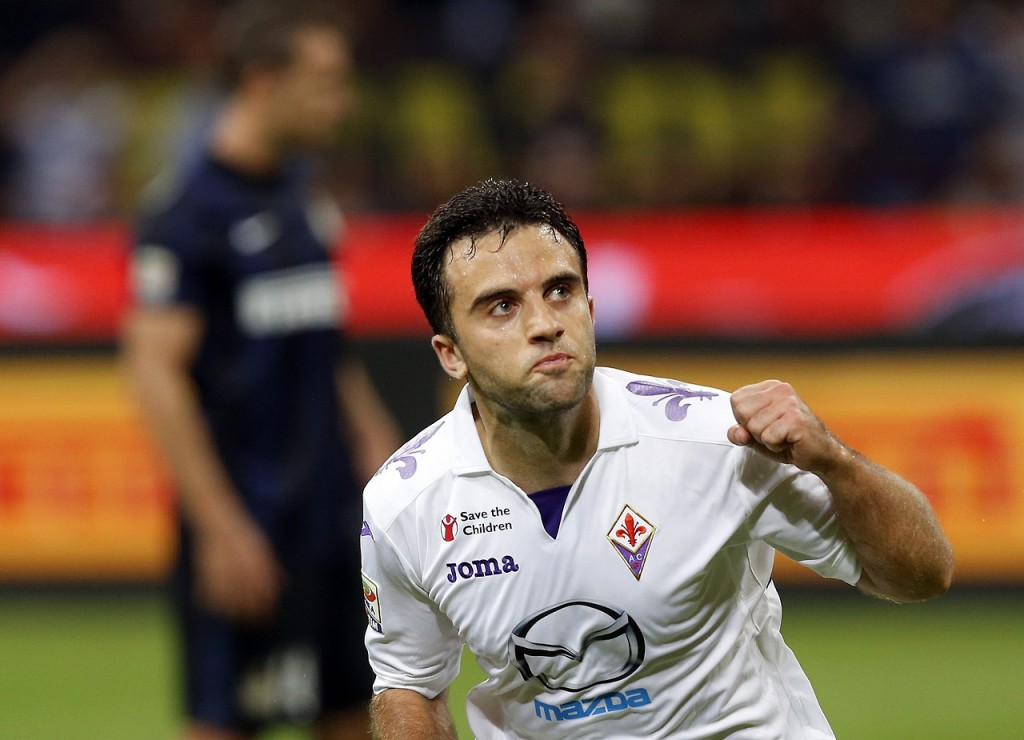 Fiorentina's Rossi celebrates after scoring a penalty against Inter Milan during their Italian Serie A soccer match at the San Siro stadium in Milan