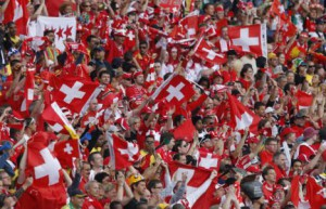 Switzerland fans wave flags before the 2010 World Cup Group H match between Spain and Switzerland at Moses Mabhida stadium in Durban