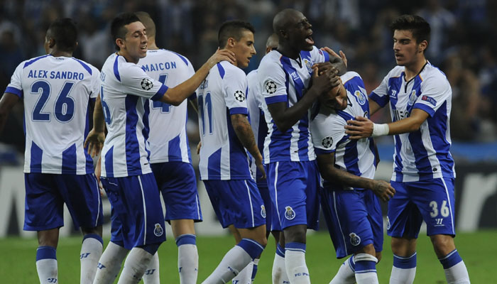Porto's players celebrate the second goal of their team against Bilbao during the Champions League Group H soccer match between FC Porto and Athletic Bilbao at Dragao Stadium in Porto, Portugal, Tuesday, Oct. 21, 2014. (AP Photo/Paulo Duarte)
