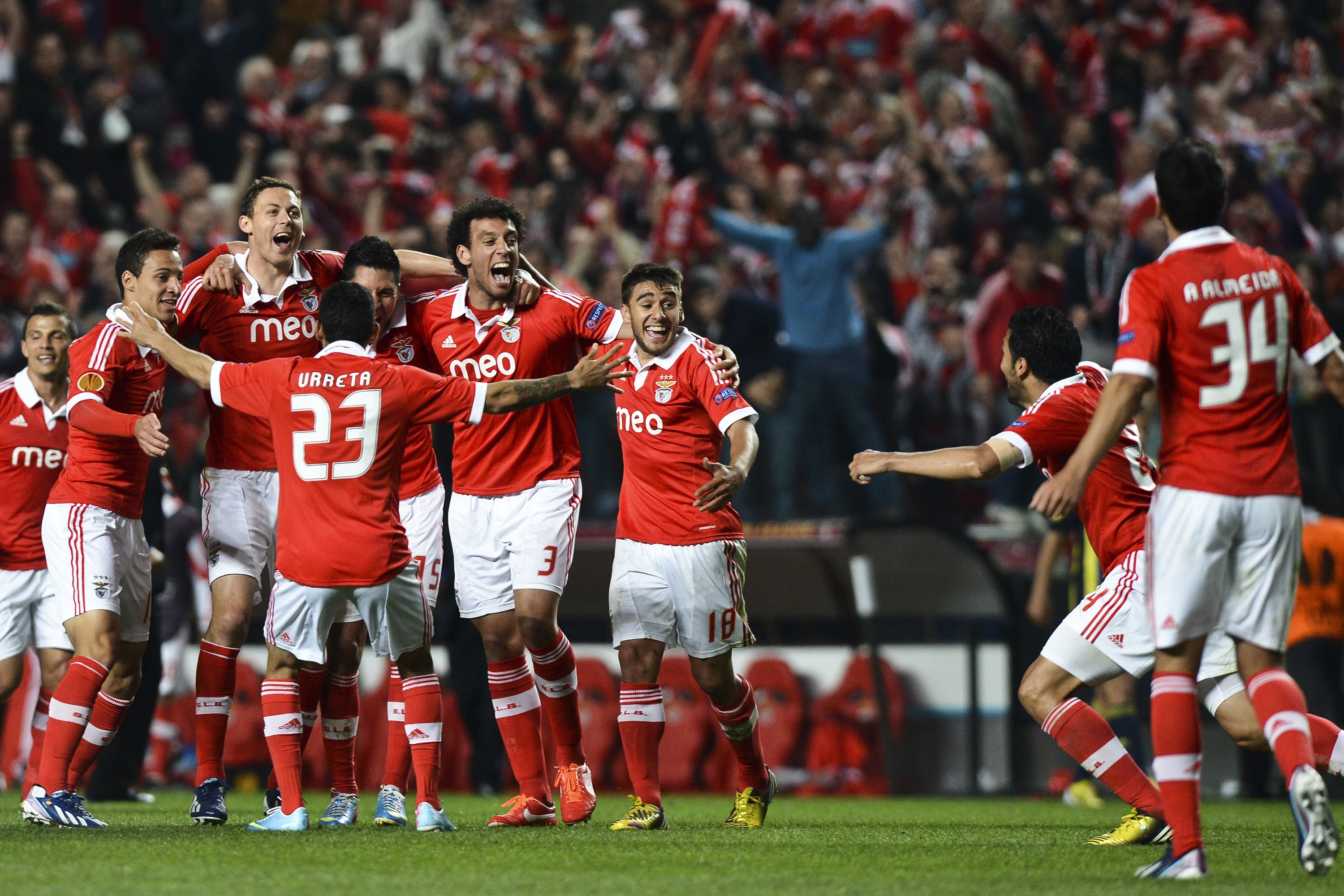 Benfica's football players celebrate their victory over Fenerbahce at the end of the UEFA Europa League semi-final second leg football match SL Benfica vs Fenerbahce SK at the Luz stadium in Lisbon on May 2, 2013. Benfica won 3-1 and is qualified for the final in The Netherlands.    AFP PHOTO/ FRANCISCO LEONG