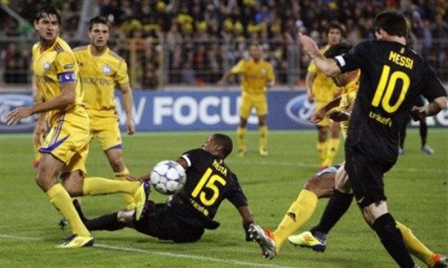 Barcelona's Lionel Messi, right, scores against BATE during their Champions League Group H soccer match in Minsk, Belarus, Wednesday, Sept. 28, 2011. (AP Photo/Ivan Sekretarev)